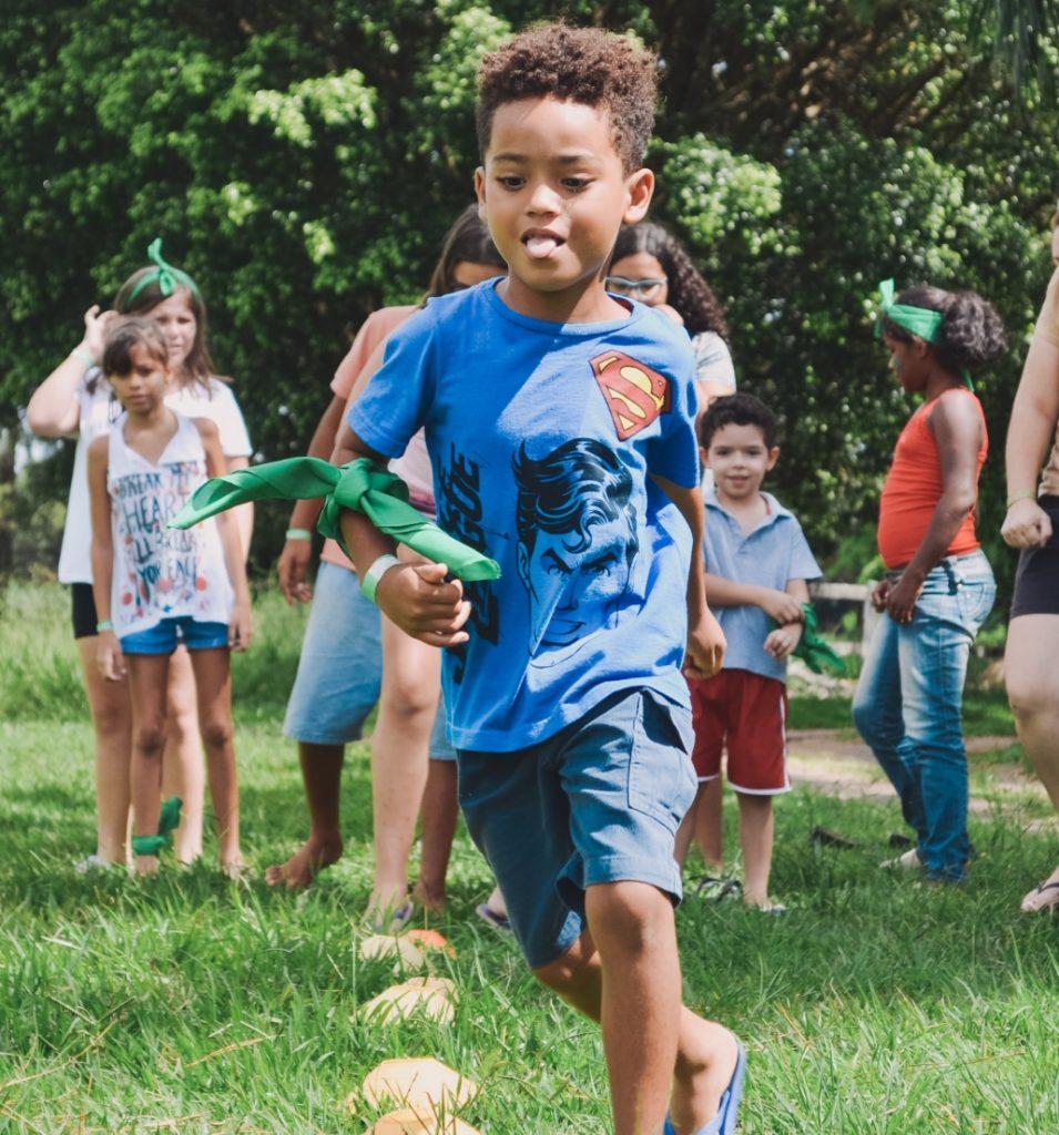 boy running at recess children in background
